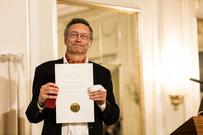 Neumann with his Nansen prize diploma. Photo: Det Norske Videnskaps-Akademi/Thomas B. Eckhoff