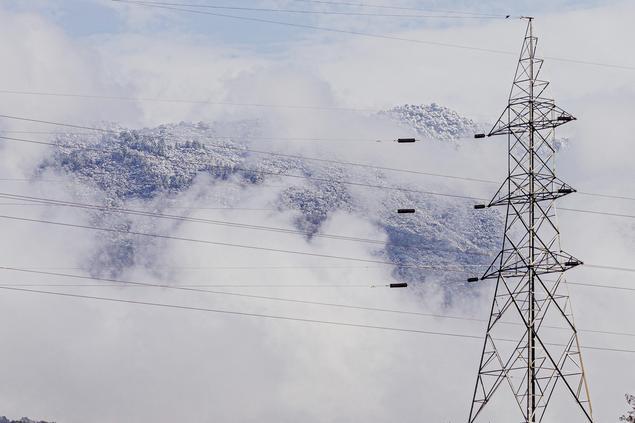 Power grid in front of winter white hills. Photo: Anil Kumar Shrestha on Unsplash