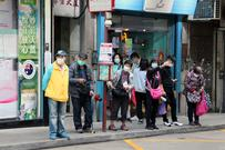 People wearing facemasks waiting for the bus in Chinas. Macau Photo Agency on Unsplash.com