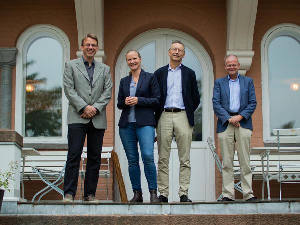 FNI researcher Lars H. Gulbrandsen, RCN director Tveit, FNI director Iver B. Neumann and Asbjørn Mo