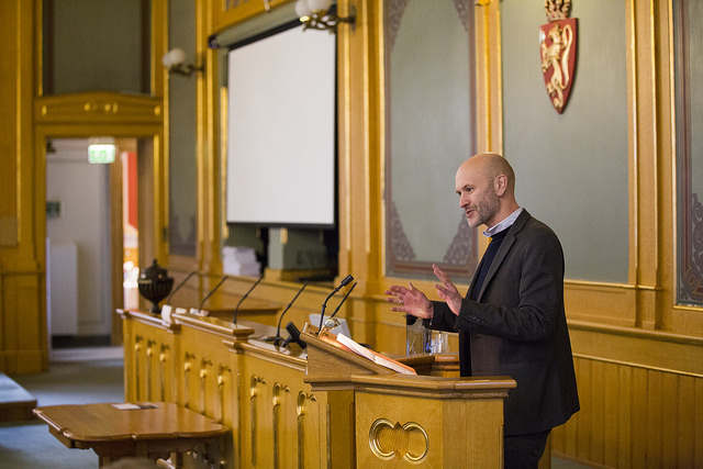 FNI researcher Svein Vigeland Rottem speaks at the Norwegian Parliament during celebration of Finland's 100th anniversary. Photo: Stortinget